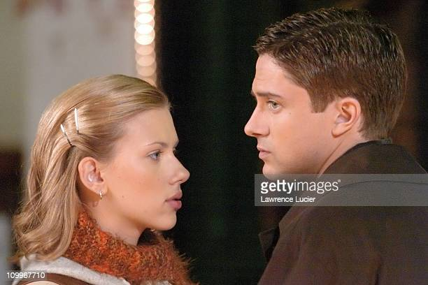 Scarlett Johansson and Topher Grace during Scarlett Johansson and Topher Grace on the Set of Synergy May 20 2004 at Little Italy in New York City New...