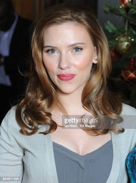 Scarlett Johansson attends a photocall to promote Frank Miller's latest film 'The Spirit' at the Mandarin Oriental in central London