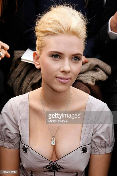 Scarlett Johansson attends the Louis Vuitton fashion show during Paris fashion week Fall/Winter 2008 at Cour carre du Louvre on March 4 2007 in Paris...