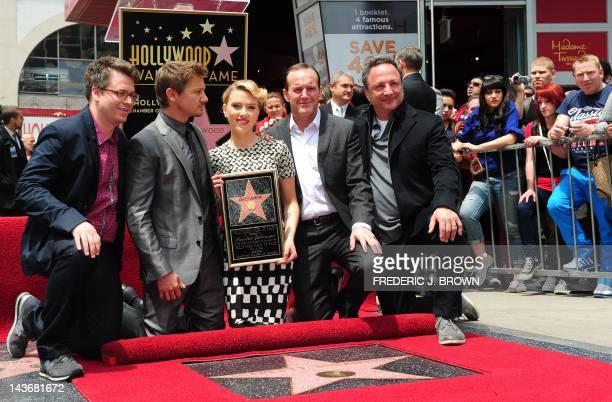 Scarlett Johansson holds a plaque while posing with cast members from her latest film 'Marvel's The Avengers' at the unveiling of her Star on the...