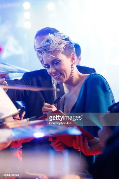 Scarlett Johansson signs autograph for fans at the World Premiere of the Paramount Pictures release 'Ghost In The Shell' at TOHO Cinemas Shinjuku on...