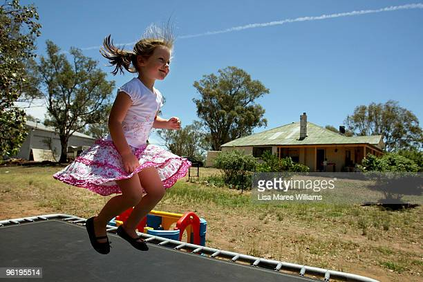 Scarlett Mercer plays on a trampoline at her country home called 'Barina' which is part of the Rentafarmhouse scheme where families can rent a...