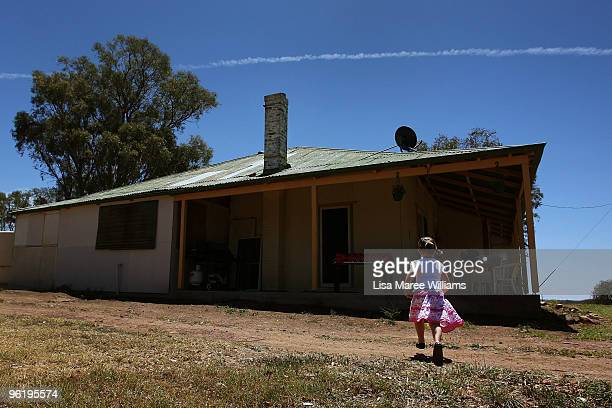 Scarlett Mercer runs in the yard of her country home called 'Barina' which is part of the Rentafarmhouse scheme where families can rent a farmhouse...