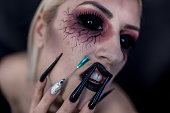 Woman with halloween make-up and nails