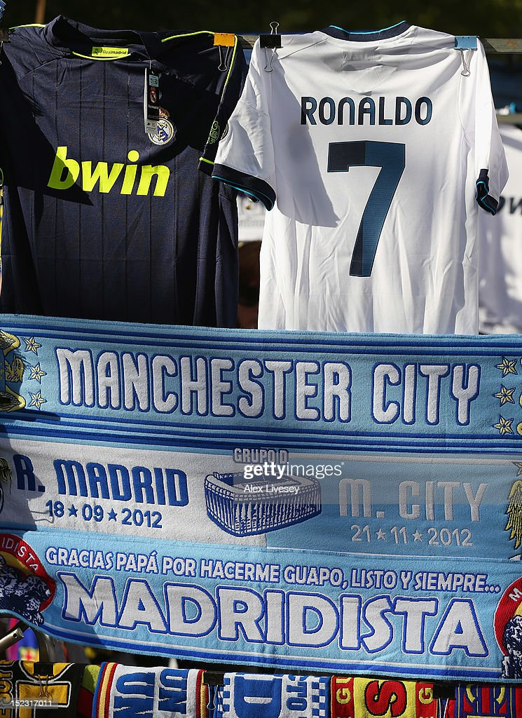 Scarves and shirts of Real Madrid and Manchester City FC are seen on sale prior to the UEFA Champions League Group D match between Real Madrid and Manchester City FC at Estadio Santiago Bernabeu on September 18, 2012 in Madrid, Spain.