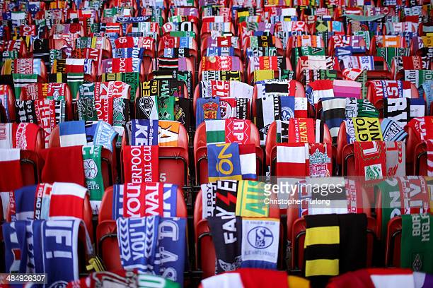 Scarves donated by fans of Liverpool and teams across the world are placed on empty seats during the memorial service marking the 25th anniversary of...