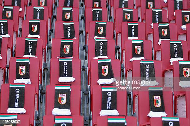 Scarves with the club logo of Augsburg are displayed ahead of the Bundesliga match between FC Augsburg and FC Bayern Muenchen at SGL Arena on...