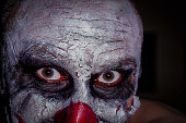 scary horror clown face  isolated on a black background colour image