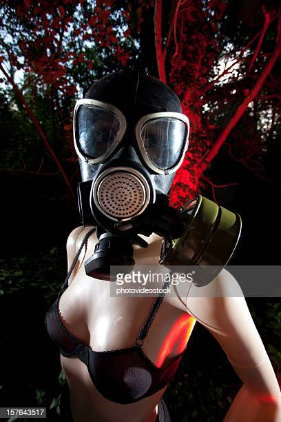 Scary dummy with gas mask and red alert lights