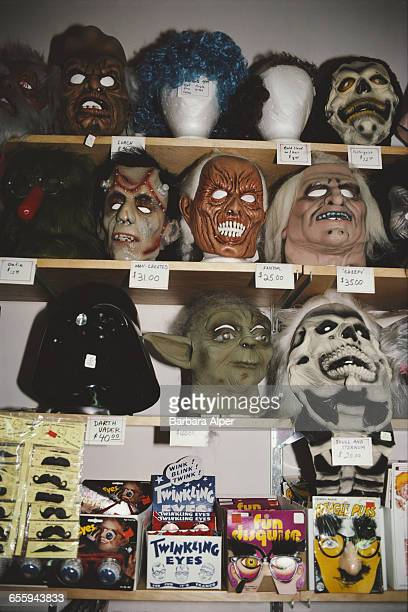 Scary Halloween masks and Star Wars character masks on display in a shop in the US August 1982