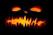 Scary Halloween pumpkin, glowing face trick or treat