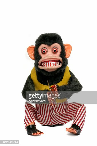scary looking vintage monkey in clothes playing cymbals stock photo