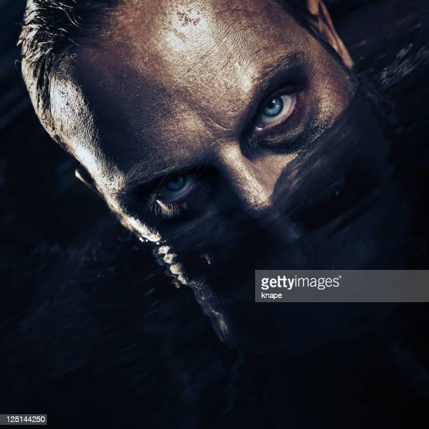 Scary man surfacing from water