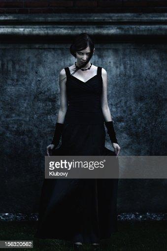 Scary woman in black dress.
