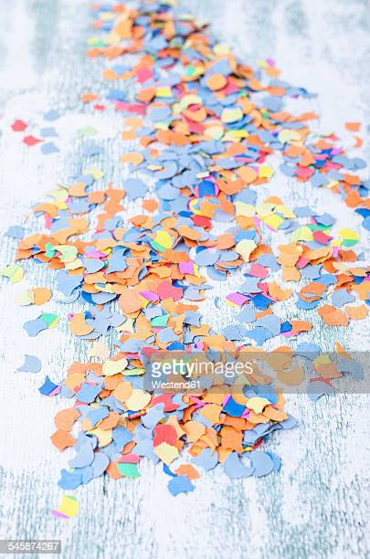 Scattered confetti on wood