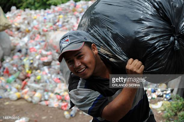 A scavenger collects plastic bottles in Tegucigalpa on June 2 three days before the celebration of the World Environment Day AFP PHOTO/Orlando SIERRA