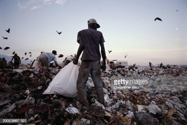 Scavengers scrape a living off Rio de Janeiro's largest rubbish dump, Brazil.