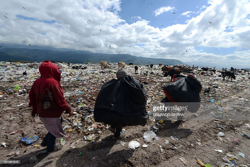 Scavengers search for food amid the garbage at the municipal rubbish dump 20 km north of Tegucigalpa on November 21 2013 Honduras one of the poorest...