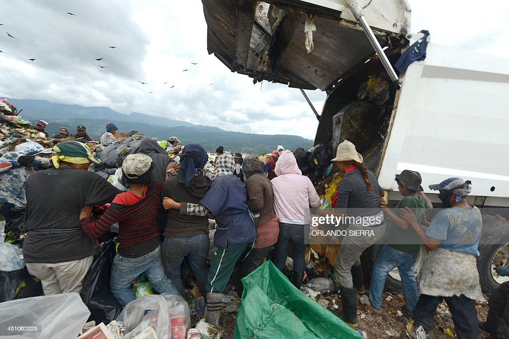 Scavengers search for food in the garbage at the municipal rubbish dump 20 km north of Tegucigalpa on November 21 2013 Honduras one of the poorest...