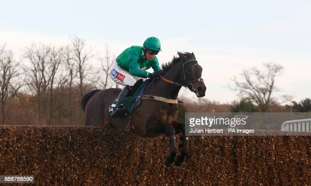 Sceau Royal and Daryl Jacob clear the last fence before going on to win The Randoxhealthcom Henry VIII Novices' Steeple Chase Race run during day two...
