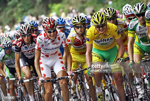 Yellow jersey USA's Floyd Landis rides with Denmark's Michael Rasmussen during the 1545 km twentieth and last stage of the 93rd Tour de France...