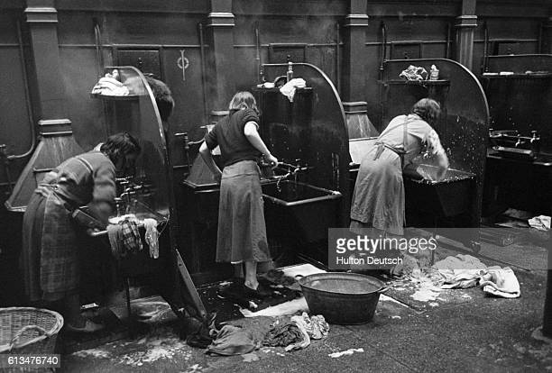 A scene at a steamie in Glasgow a wash house attached to the public baths where housewives who lack washing facilities in their own homes can bring...