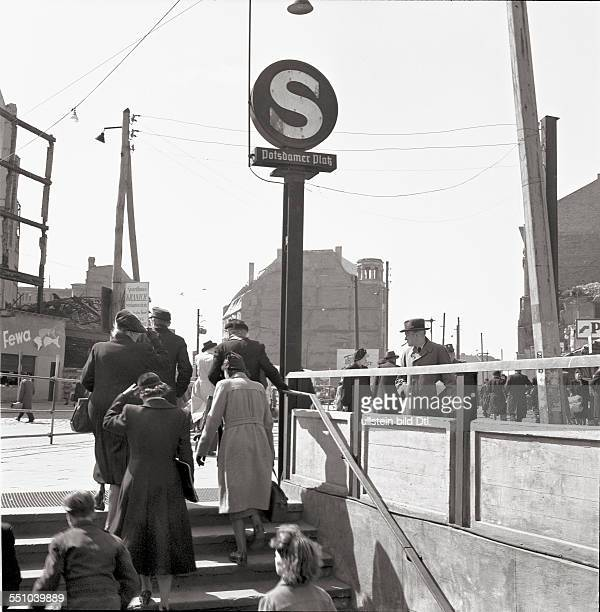 A scene at the Potsdamer Platz People at the entrance of the SBahn station in the back ground the famous Weinhaus Hut Photographer Ernst Hahn