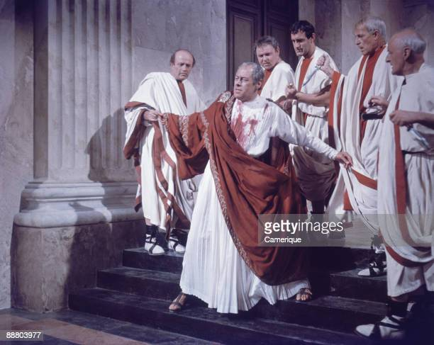 Scene depicting the assassination of Julius Caesar played by Rex Harrison from the movie Cleopatra 1963