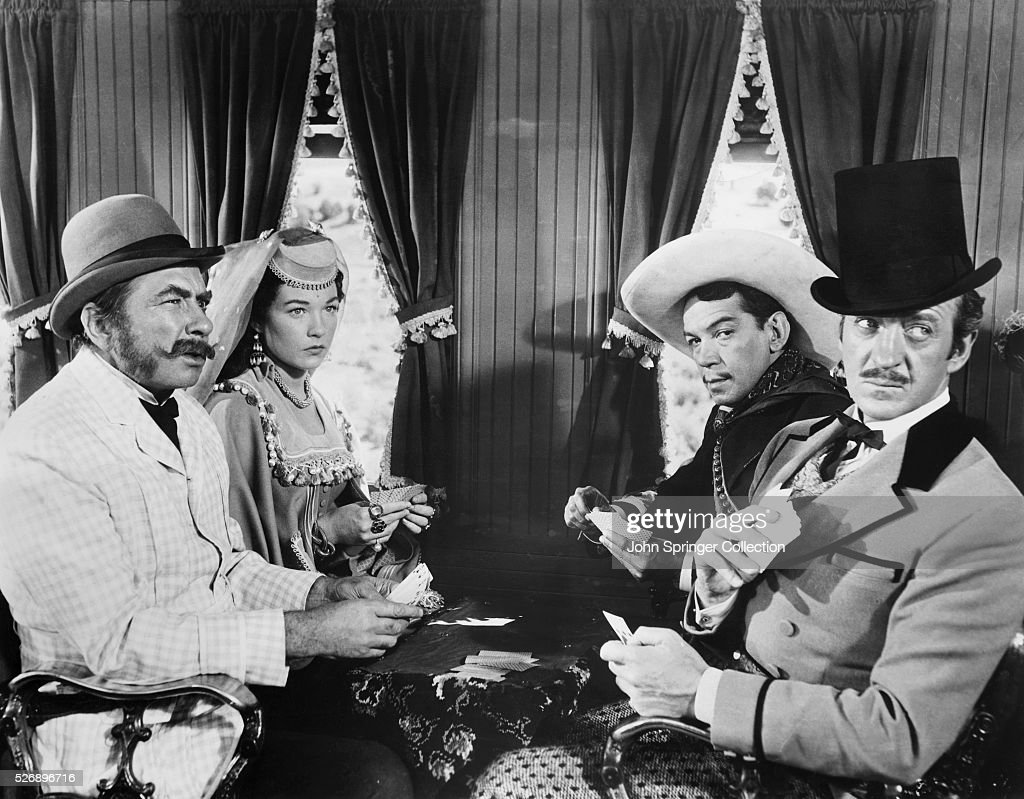A scene from Around the World in Eighty Days. The film stars (from left): Edmund Lowe, Shirley MacLaine, Cantinflas, and David Niven.