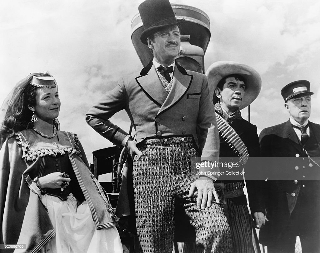 A scene from Around the World in Eighty Days. The film stars (from left): Shirley MacLaine, David Niven, Cantinflas, and Buster Keaton.