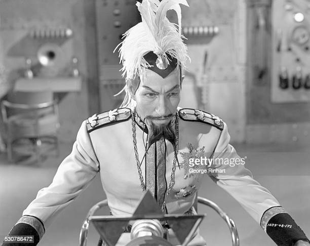Scene from 'Flash Gordon Conquers the Universe' in which Emperor Ming the merciless of Mongo broadcasts orders to his henchmen to destroy the...