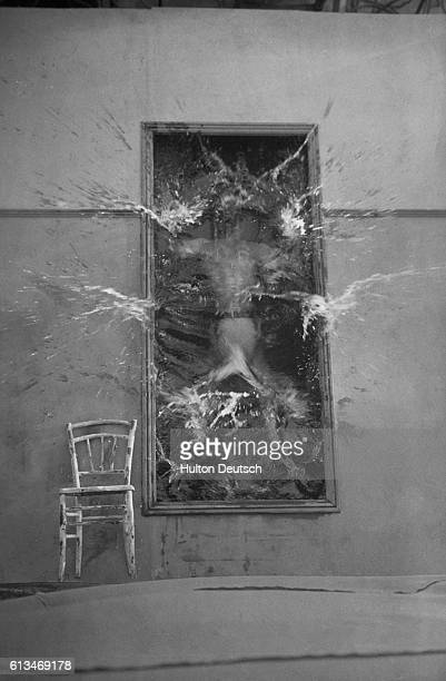 A scene from Jean Cocteau's play 'Le Sang d'un Poete' ca 1925 In an optical illusion a man dives into a tall mirror The mirror is actually a pool of...