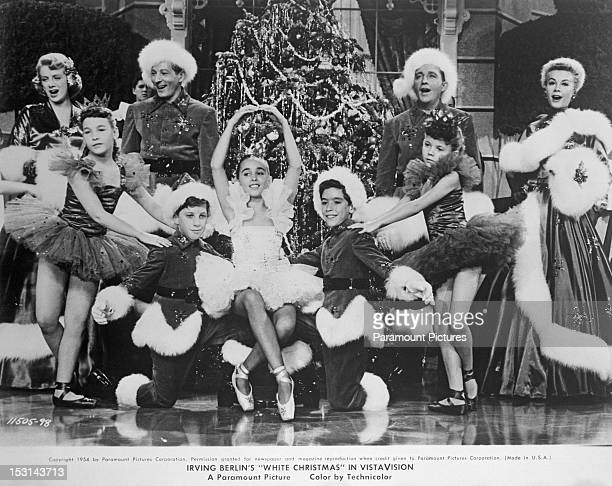A scene from the American film version of Irving Berlin's musical 'White Christmas' directed by Michael Curtiz 1954 Standing behind the children are...