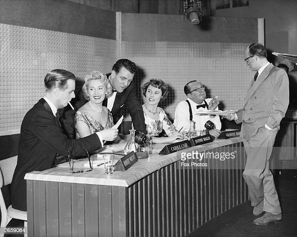 A scene from the film 'Right Left And Centre' a skit of a popular game show From left to right are Ian Carmichael Carol Carr Eamonn Andrews Josephine...