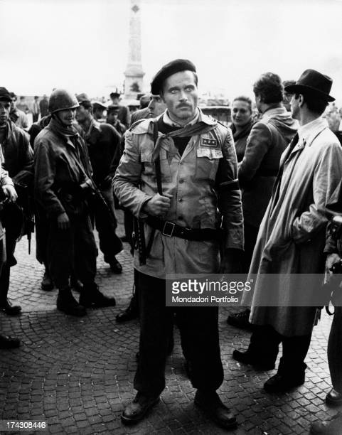 A scene from the historical movie Last Days of Mussolini with actors and walkson wearing stage costumes the actor Franco Nero performs the partisan...