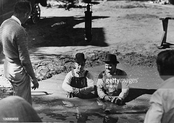 Scene from the last film by Stan Laurel and Oliver Hardy 'Atoll K' in which they had to take a bath in a puddle of mud France Photogrpahy 1950