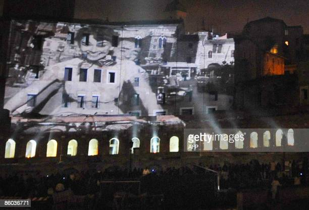 A scene from the movie Roman Holiday is projected on the ancient buidings of the Foro Traiano during the performance for the celebration of the...