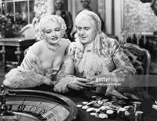A scene from the movie 'Voltaire' with Doris Kenyon as Mme Pompadour and Reginald Owen as King Louis XV who gambles at a roulette wheel Hollywood...