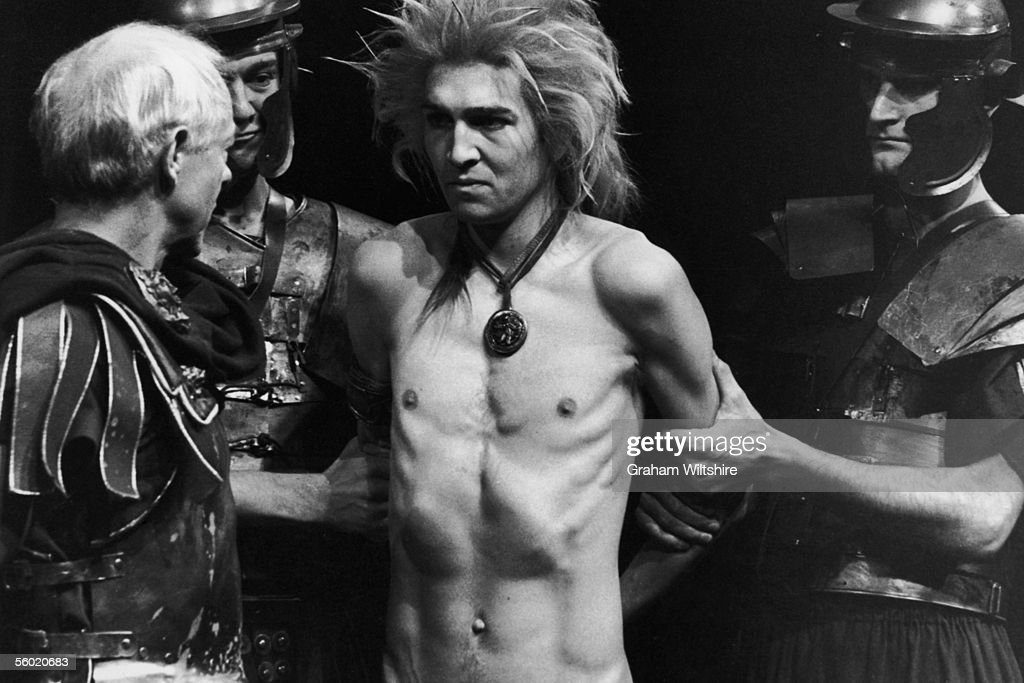 A scene from the play 'The Romans In Britain', by Howard Brenton, directed by Michael Bogdanov at the National Theatre, London. 16th October 1980. A celtic druid, played by Greg Hicks, is interrorgated by Romans.