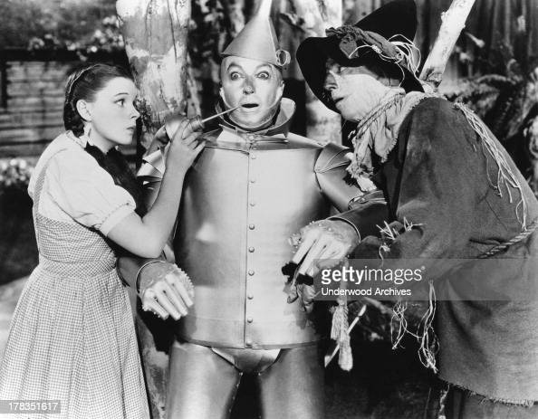 A scene from the Wizard of Oz with Dorothy the Tin Woodman and Scarecrow as played by actors Judy Garland Jack Haley and Ray Bolger Hollywood...