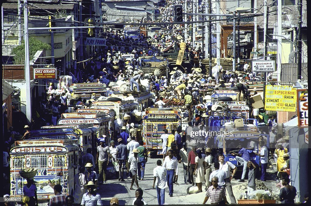 Scene in Port Au Prince during election campaign, showing streets crowded with pedestrians.
