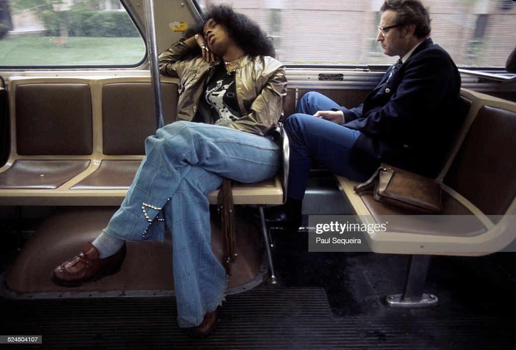 Scene inside one of the city's elevated trains, with two passengers seated by the window, Chicago, Illinois, late 1970s or early 1980s.