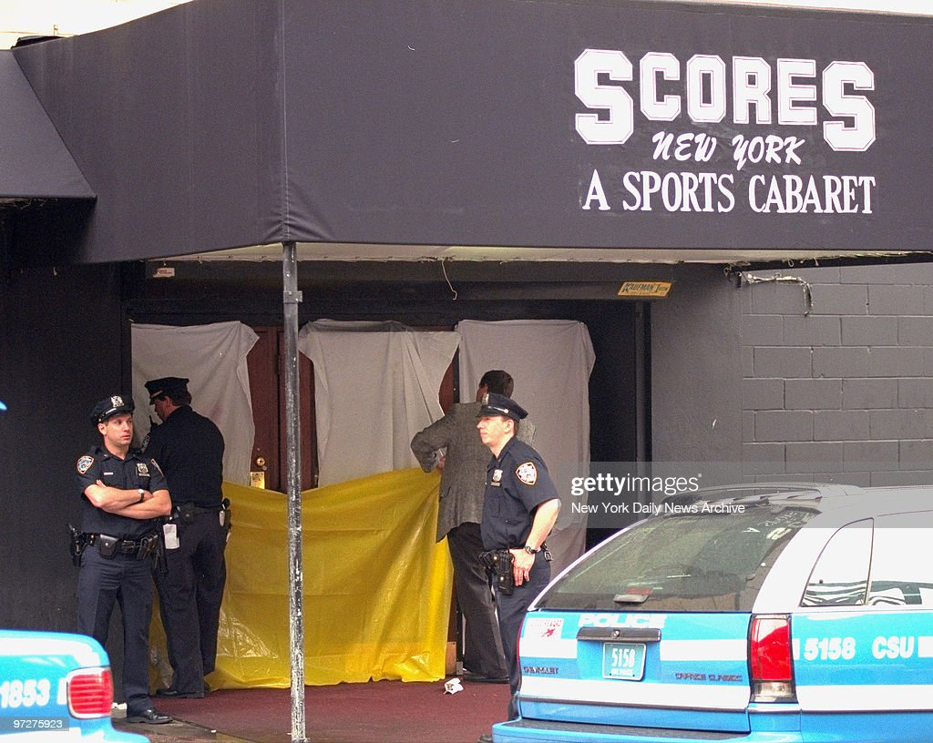 scene of shooting at scores night club police put up sheets