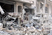 A scene of the alSukari neighborhoods of Aleppo Syria on December 20 2013 following an airstrike of Syrian Air Forces The strikes in several...