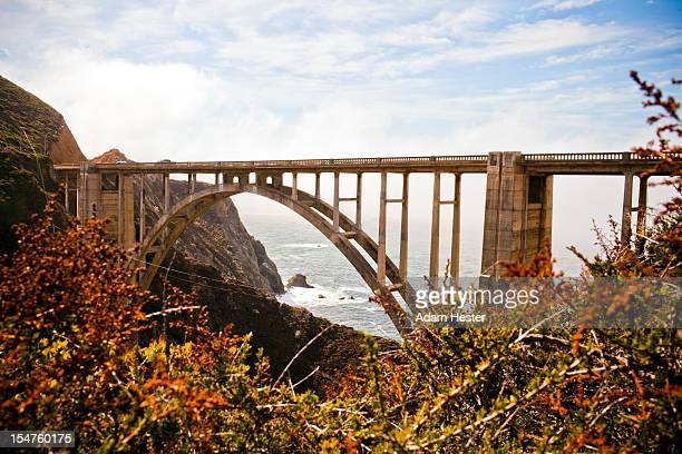 A scene of the Bixby Bridge during the day.