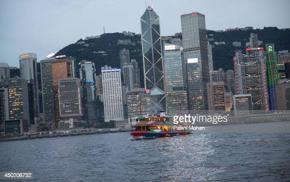 A scene of Victoria Harbour at dusk with the lights of Central in the distance shot from the Star Ferry on June 6 2014 in Hong Kong The ferry which...