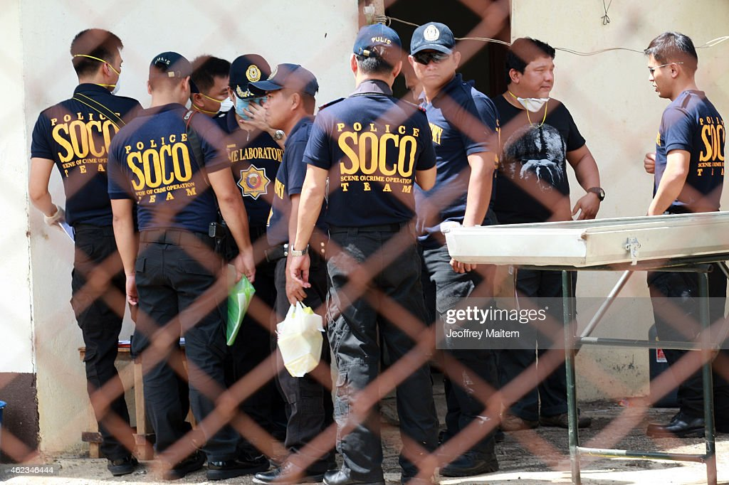 Scene ofthe Crime Operatives of Philippine National Police are seen on January 27, 2015 inside a military morgue in Datu Odin Sinsuat, Maguindanao Province, Philippines. Dozens of elite policemen were killed after a clash with a Muslim rebel group. Lawmen were trying to serve arrest warrants on January 25, 2015 for criminals led by Malaysian bomb maker Zulkifli bin Hir, known in military and police officials as Marwan, when the group clashed with the guerillas under Commander Guiawan of Bangsamoro Islamic Freedom Fighters, a breakaway group of the Moro Islamic Liberation, the countrys largest rebel group engaged in peace talks with Manila. The death toll of government fatalities in the fierce firefight reached fifty.