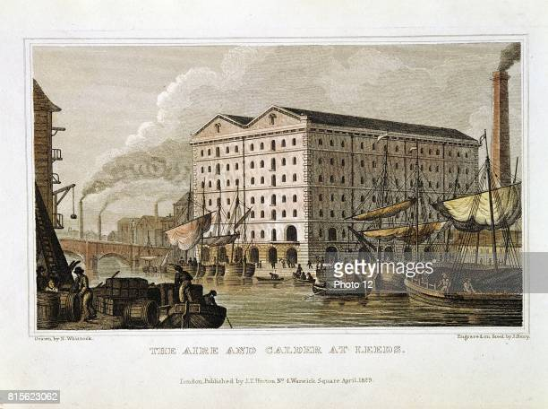 Scene on the Aire and Calder Navigation Leeds Yorkshire showing shipping warehousing and smoking chimneys in background From 'History of the County...