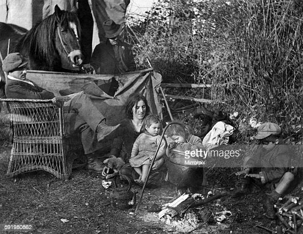 A scene on the road near Ledbury Gypsies have pulled up by the roadside for their evening meal and a warm Known as a hard living race a Wicker...