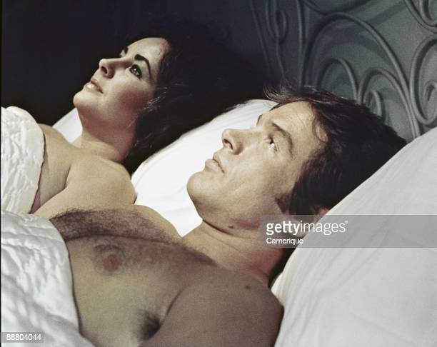Scene showing Warren Beatty lying down next to Elizabeth Taylor from the movie 'Only Game in Town' 1970